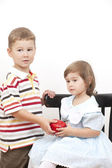 Boy gives to the girl red apple — Stock Photo