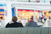 Business woman in a waiting room at the airport — Stock Photo