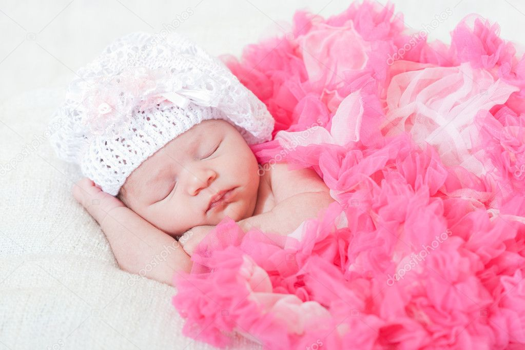 Sleeping small princess in pink laces (the newborn girl)  Stock Photo #11967409