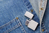 Lighter and Denim — Stock Photo
