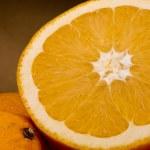 Half an orange — Stock Photo #11584299