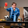 Soccer fan on sofa — Stock Photo #10771062
