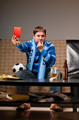 Soccer fan on sofa — Stock Photo