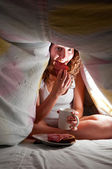 Eating at bed — Stock Photo