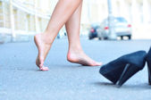 Female bare feet dancing on summer street — Stock Photo