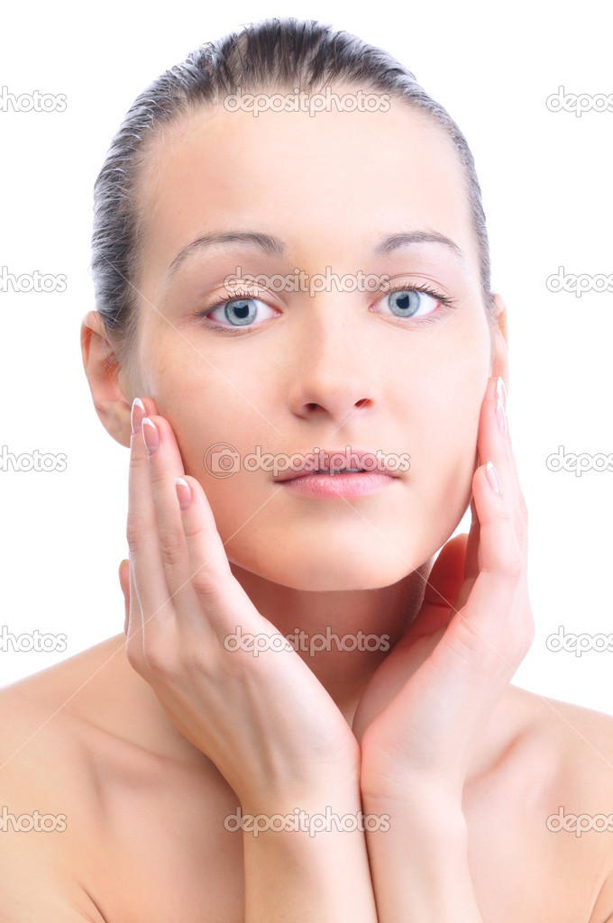 Happy beautiful woman is touching her face and looking at camera — Stock Photo #10787937