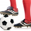 Legs of soccer player - Stock Photo