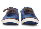 Blue plimsolls — Stock Photo