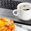 Laptop and cup of coffee — Stock Photo