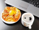 Laptop and cup of coffee — Stok fotoğraf