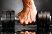 Male hand is holding metal barbell — Foto de Stock