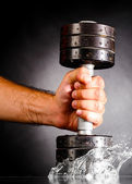 Metal barbell splashes in water — Stock Photo