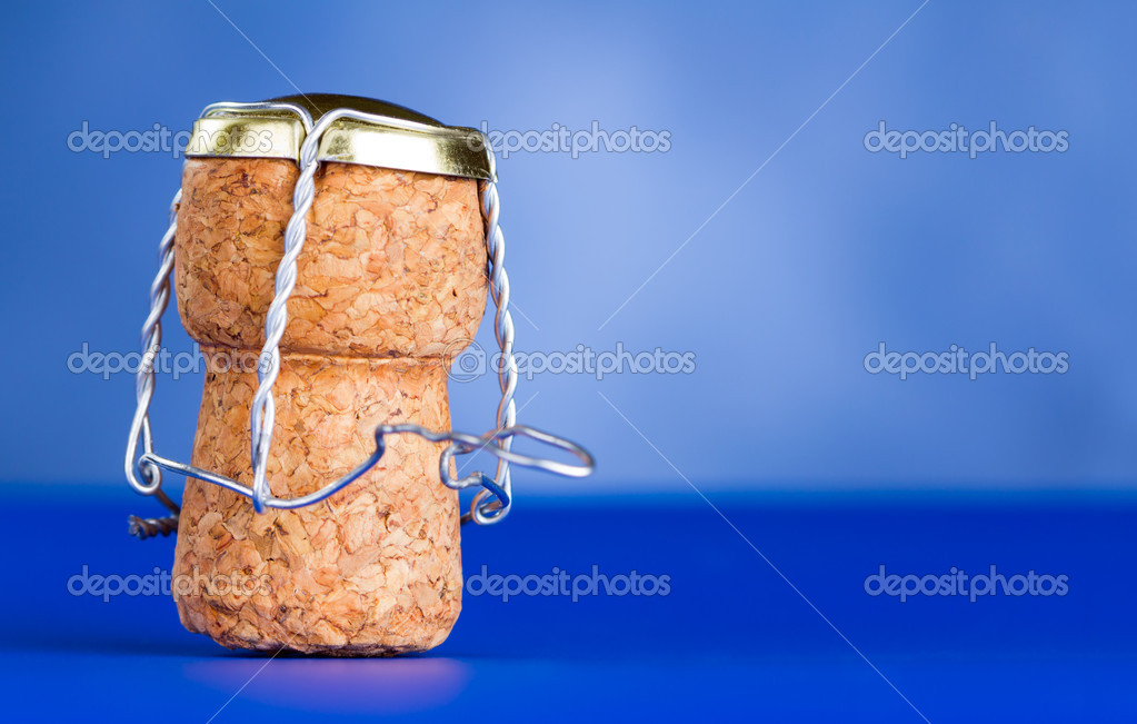 Champagne cork on a blue background — Stock Photo #11719809