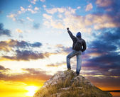 Man on peak of mountain. — Stock Photo