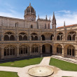 Court with fountain in Jeronimos monastery, Belem. Lisbon - Stock Photo