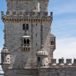 Belem tower over blue sky with clouds - Stock Photo