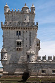 Belem tower over blue sky with clouds — Stock Photo