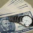 Stock Photo: Money and watch