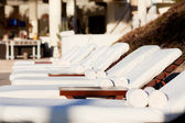 Sunbeds by the pool — Stock Photo