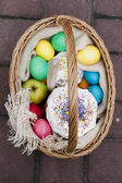 Easter food in basket (kulich and eggs) — Stock Photo
