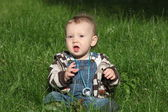 A boy (child / kid) is playing outdoors in the garden — Stock Photo