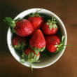Strawberries In White Ceramic Bowl - Stock Photo