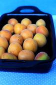Apricots In Black Ceramic — Stock Photo