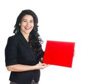 Linda morena com um sinal vermelho nas mãos de — Foto Stock