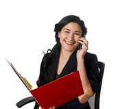 Triumphant woman in a red folder hears good news on the phone — Stock Photo