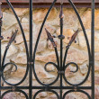 Wrought-iron fence close-up - Stock Photo
