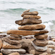 Inuksuk or Inkukshuk on the Huron lakeshore - Stock Photo