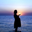 Pregnant lady on sunset — Stock Photo