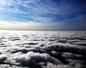 Puffy clouds at sunset — Stock Photo