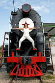 Merry female on vintage locomotive — Stock fotografie