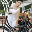 An elegant lady travels on bicycle — Stock Photo