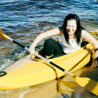 Cute girl in a yellow kayak — Stock Photo