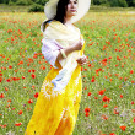 Cute brunette on the poppy field — Stock Photo #11957547