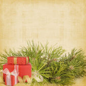 Christmas greeting vintage card with branches of spruce — Stock Photo