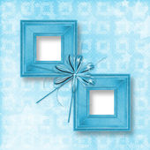 Old blue wooden frames Victorian style with bow and ribbons — Zdjęcie stockowe