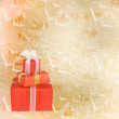 Holiday gift boxes decorated with bows and ribbons on the abstra — Stock Photo