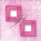 Old pink wooden frames Victorian style with bow and ribbons — Stock Photo