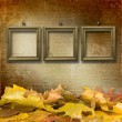 Royalty-Free Stock Photo: The fallen leaves on the background wall with vintage wallpaper