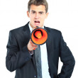 Business man screaming loudly in a megaphone — Stock Photo