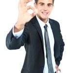obchodní muž ukazuje výborně proti různému pozadí — Stock fotografie