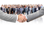 Shaking hands and business team — Stock Photo