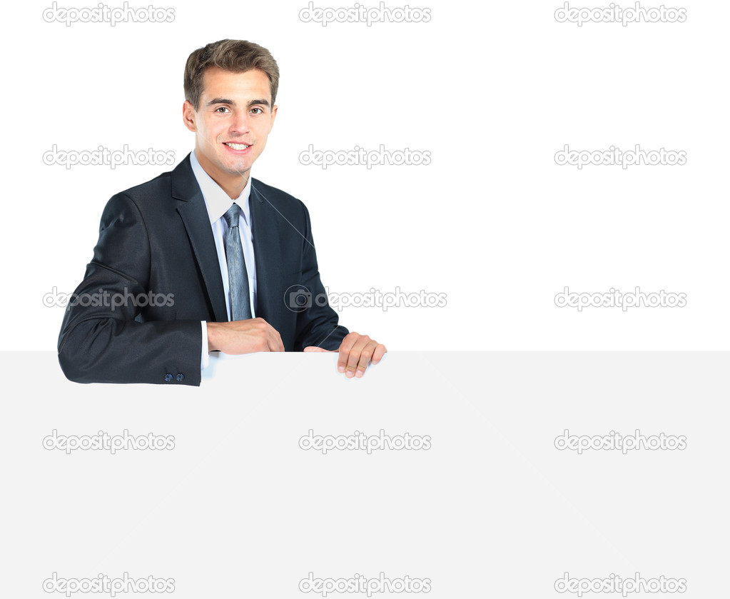 Happy smiling young business man showing blank signboard — Stock Photo #11041258