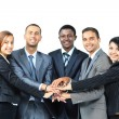 A diverse group of business workers with their hands together in form of teamwork - Zdjęcie stockowe