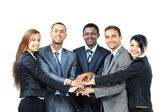 A diverse group of business workers with their hands together in form of teamwork — Stock Photo