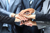 Closeup portrait of group of business with hands together — Stock Photo