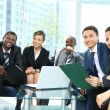 Satisfied proud business team looking at camera and smiling in office — Stock Photo #11832027